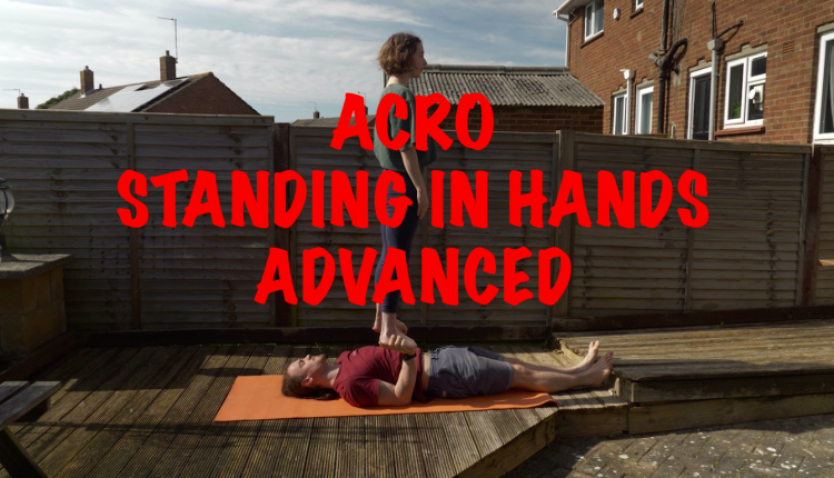 Acro Standing in hands banner