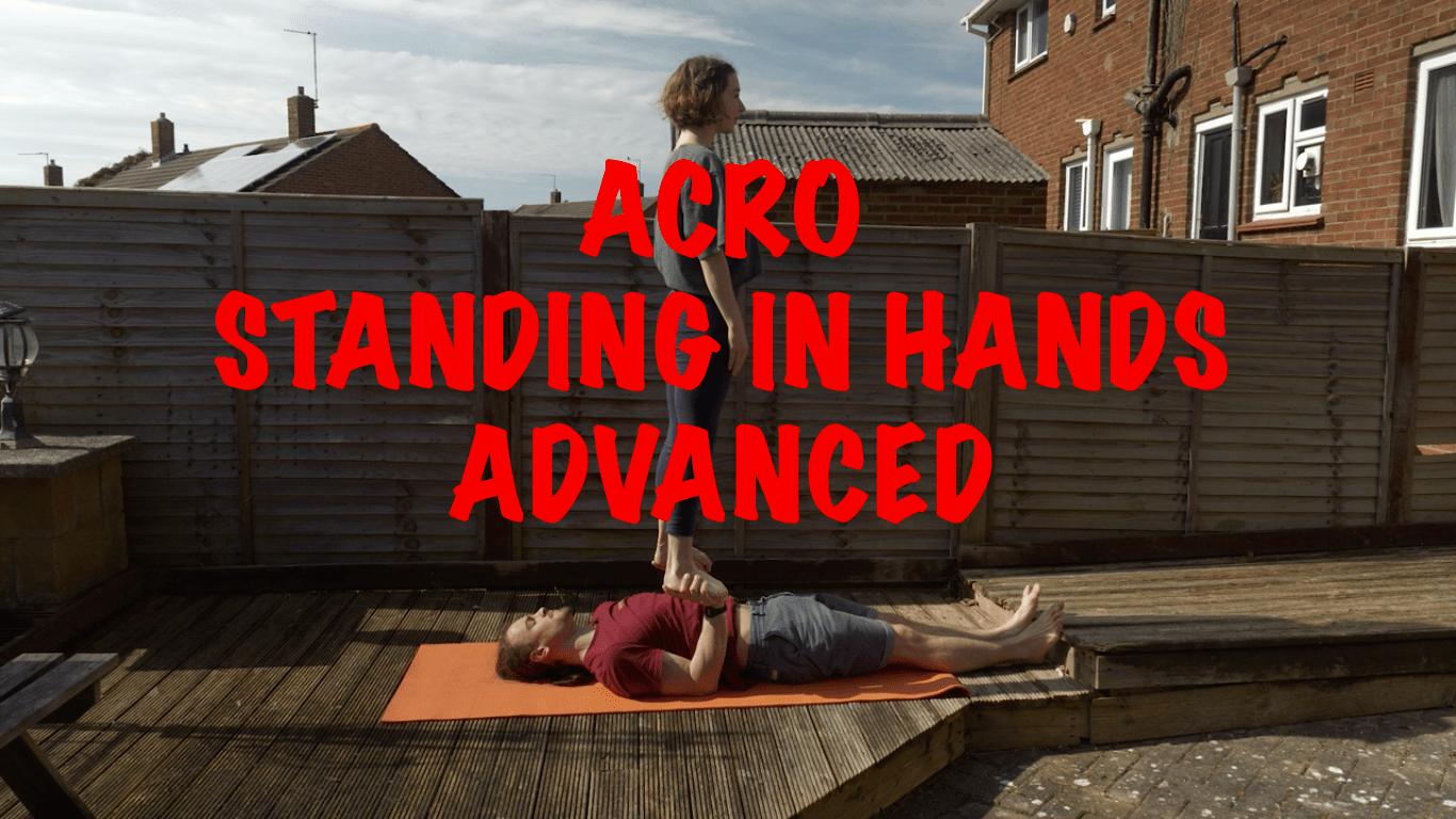 Acro Standing in hands banner